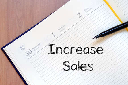 increase sales: Increase sales text concept write on notebook with pen Stock Photo