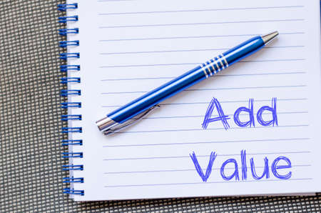 involvement: Add valuer text concept write on notebook with pen