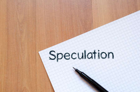 deliberation: Speculation text concept write on notebook with pen