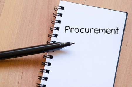 procure: Procurement text concept write on notebook with pen