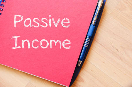 passive income: Passive income text concept write on notebook with pen Stock Photo