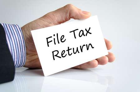 accounting records: Archivo declaraci�n de impuestos concepto de texto aislados sobre fondo blanco