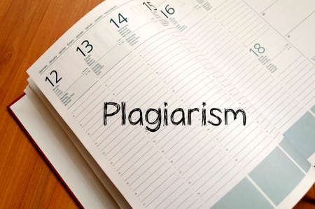 copycat: Plagiarism text concept write on notebook with pen