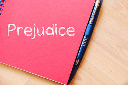 Prejudice text concept write on notebook with pen Stock Photo