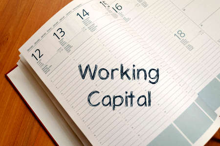 stockholders: Working capital text concept write on notebook with pen