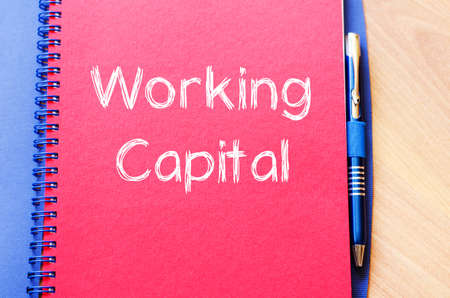Working capital text concept write on notebook with pen