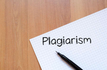 plagiarism: Plagiarism text concept write on notebook with pen