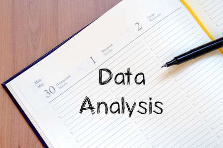 compile: Data analysis text concept write on notebook with pen