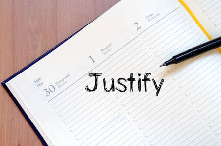justify: Justify text concept write on notebook with pen Stock Photo