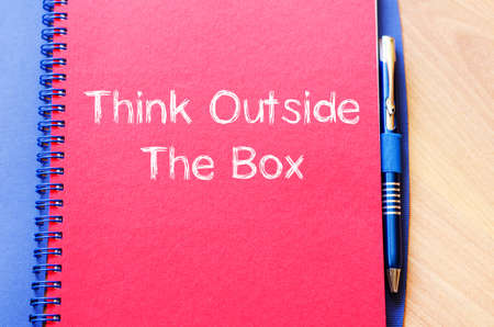 different goals: Think outside the box text concept write on notebook with pen Stock Photo