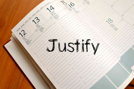 Justify text concept write on notebook with pen Stock Photo