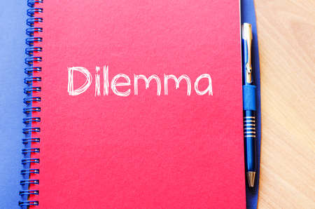 health symbols metaphors: Dilemma text concept write on notebook with pen