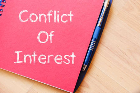 resolution: Conflict of interest text concept write on notebook with pen