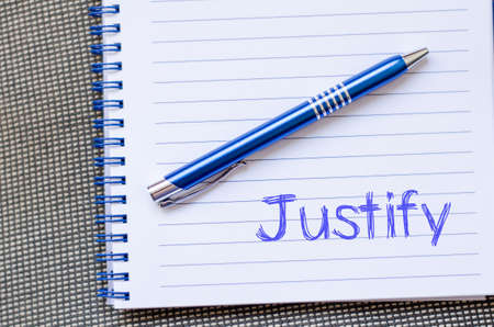 substantiate: Justify text concept write on notebook with pen Stock Photo