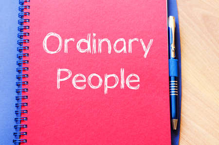 ordinary: Ordinary people text concept write on notebook with pen