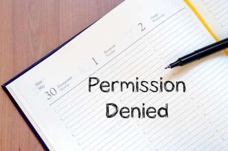 permission: Permission denied text concept write on notebook with pen Stock Photo