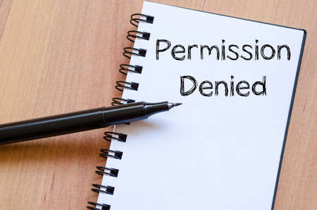 disclaim: Permission denied text concept write on notebook with pen Stock Photo