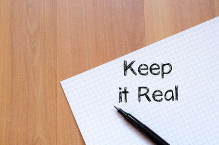 grammatical: Keep it real text concept write on notebook with pen Stock Photo