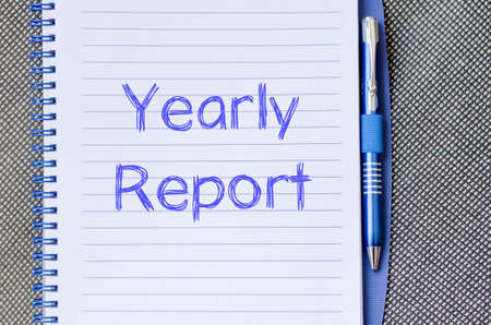 disclose: Yearly report text concept write on notebook with pen Stock Photo