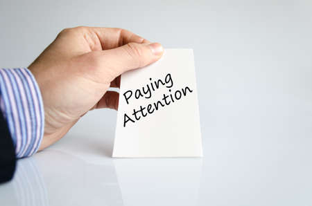 over paying: Paying attention text concept isolated over white background