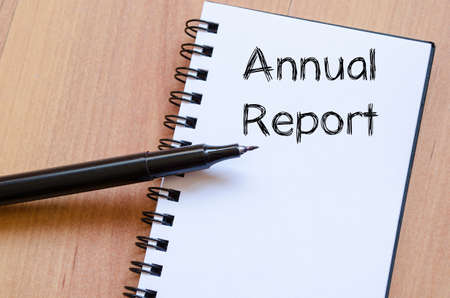 year financial statements: Annual report text concept write on notebook with pen Stock Photo