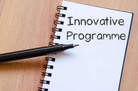 programme: Innovative programme text concept write on notebook with pen