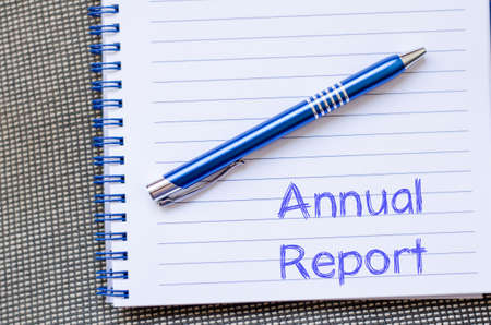 disclose: Annual report text concept write on notebook with pen Stock Photo
