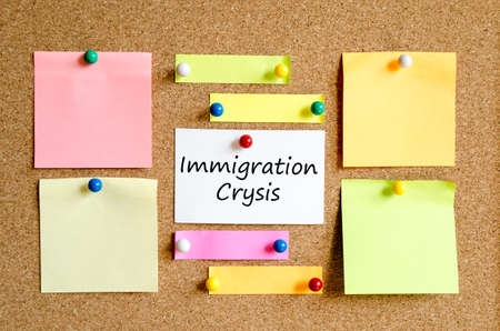 immigrate: Colorful sticky notes on cork board background Stock Photo
