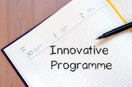 innovative: Innovative programme text concept write on notebook with pen