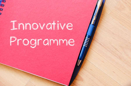 communication capability: Innovative programme text concept write on notebook with pen