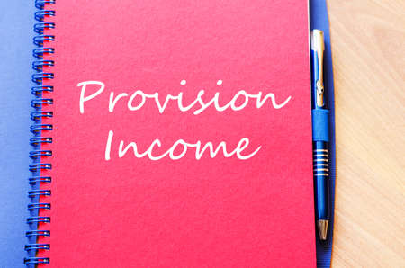 provision: Provision income text concept write on notebook Stock Photo