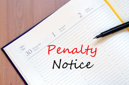 Penalty notice text concept write on notebook