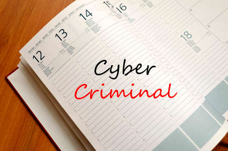 scammer: Cyber criminal text concept write on notebook
