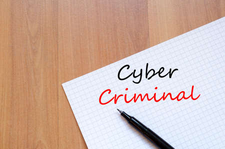 scammer: Cyber criminal text concept write on notebook with pen Stock Photo