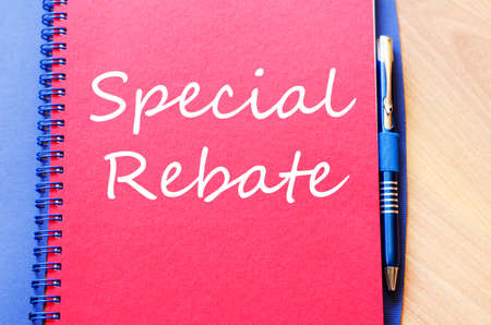 rebate: Special rebate text concept write on notebook with pen Stock Photo