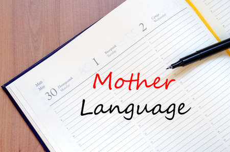 dialect: Mother language text concept write on notebook