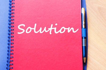 Solution text concept write on notebook with pen Stock Photo