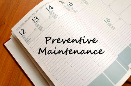 preventive: Preventive maintenance text concept write on notebook with pen Stock Photo
