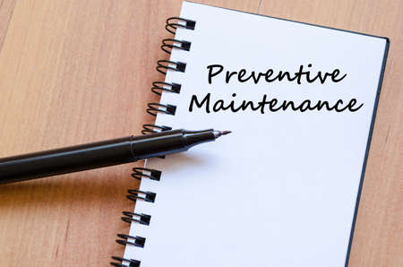 scheduled replacement: Preventive maintenance text concept write on notebook with pen Stock Photo
