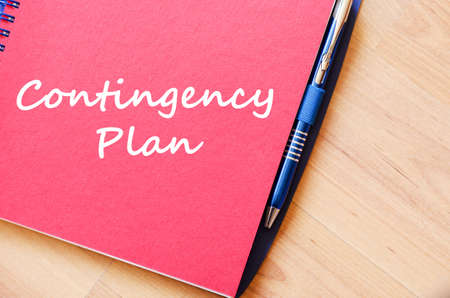 contingency: Contingency plan text concept write on notebook with pen Stock Photo