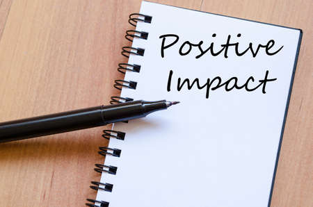 different goals: Positive impact text concept write on notebook with pen