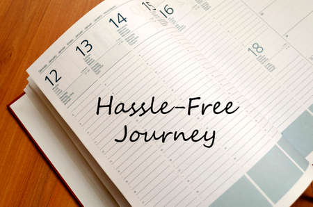 hassle: Hassle free journey text concept write on notebook
