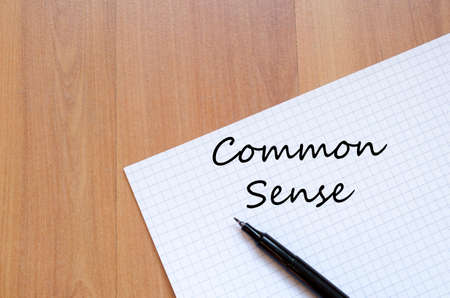 common sense: Common sense text concept write on notebook with pen