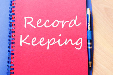 Record keeping text concept write on notebook with pen
