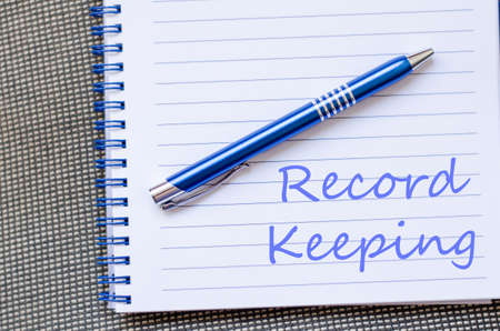 data protection act: Record keeping text concept write on notebook with pen