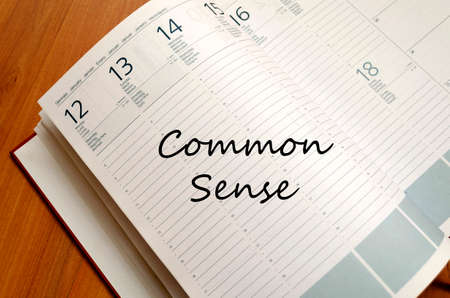common sense: Common sense text concept write on notebook Stock Photo