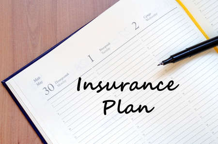 insurer: Insurance plan text concept write on notebook with pen