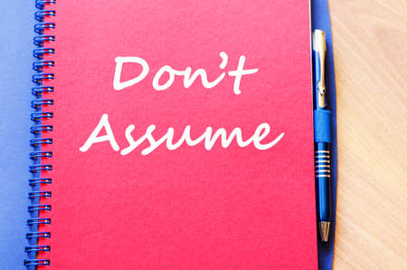 assume: Dont assume text concept write on notebook with pen