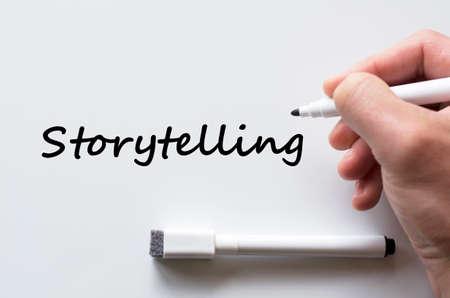 Human hand writing storytelling on whiteboard