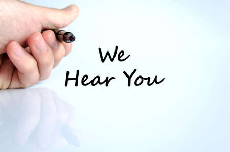 We hear you text concept isolated over white background Stock Photo